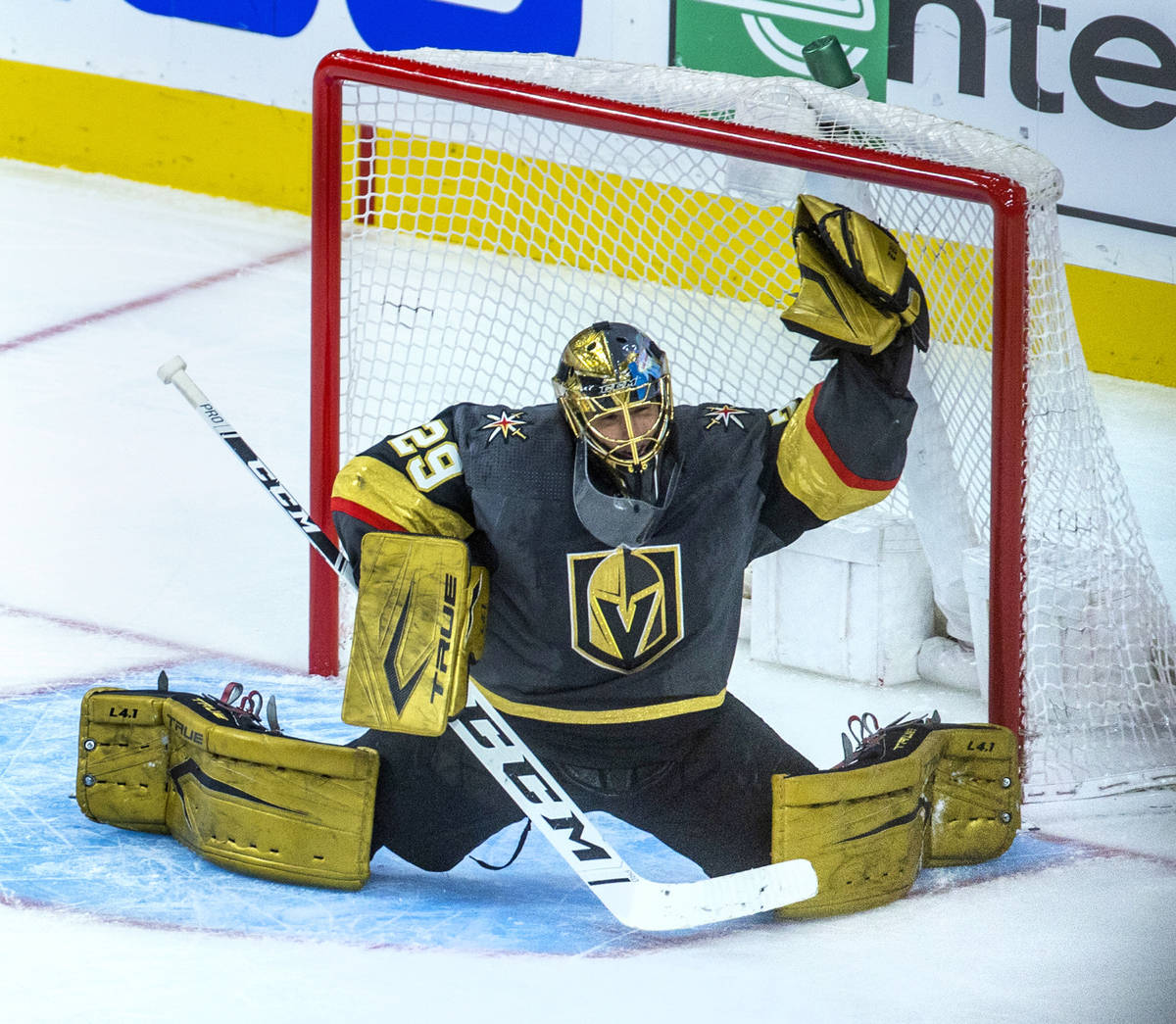 Golden Knights goaltender Marc-Andre Fleury reaches up for another stop versus the Minnesota Wi ...