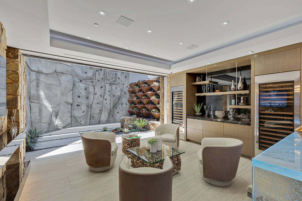 The home has a two-story rock-climbing wall in the basement. (The Ivan Sher Group)