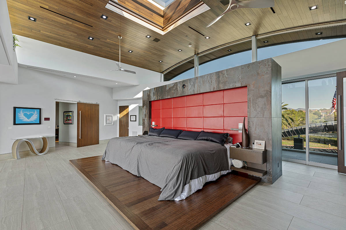 The master bedroom, which has direct access to one of the three garages, also features a retrac ...
