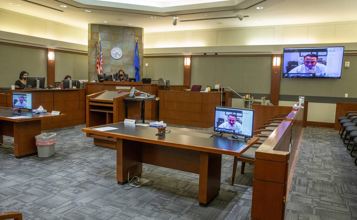 Clark County Deputy Public Defender Ryan Bashor speaks during the initial arraignment for Saman ...