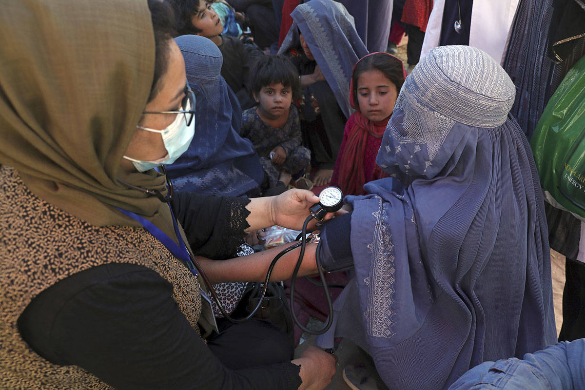 FILE - In this Aug. 10, 2021 file photo, an internally displaced woman from northern provinces, ...
