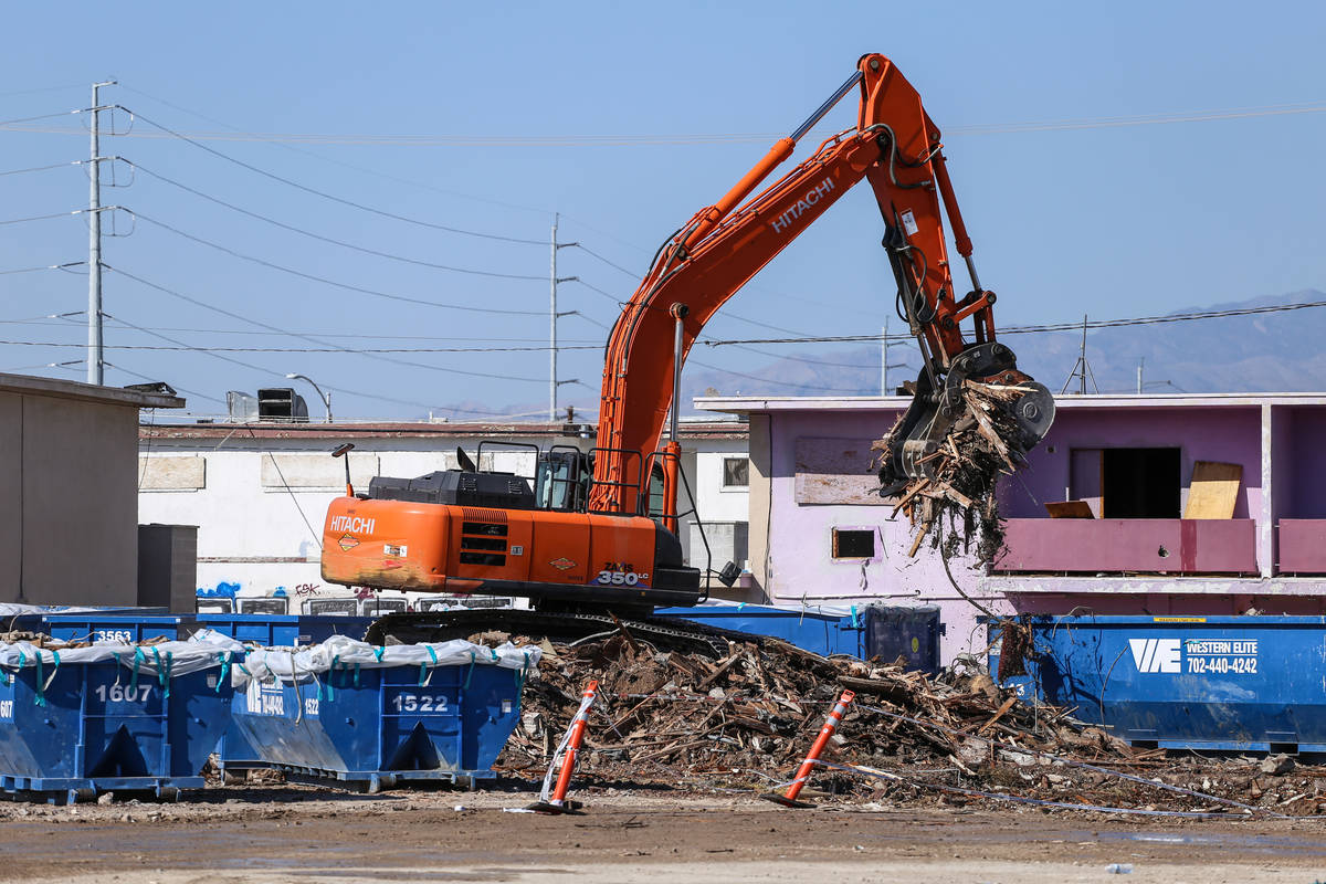 A crane lifts remnants of the demolished Moulin Rouge into dumpsters in Las Vegas, Thursday, Oc ...
