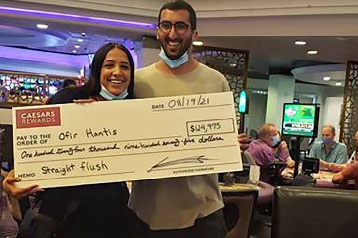 Ofir Hantis, right, poses after winning a $124,975 jackpot at Harrah's on Thursday, Aug 19, 202 ...