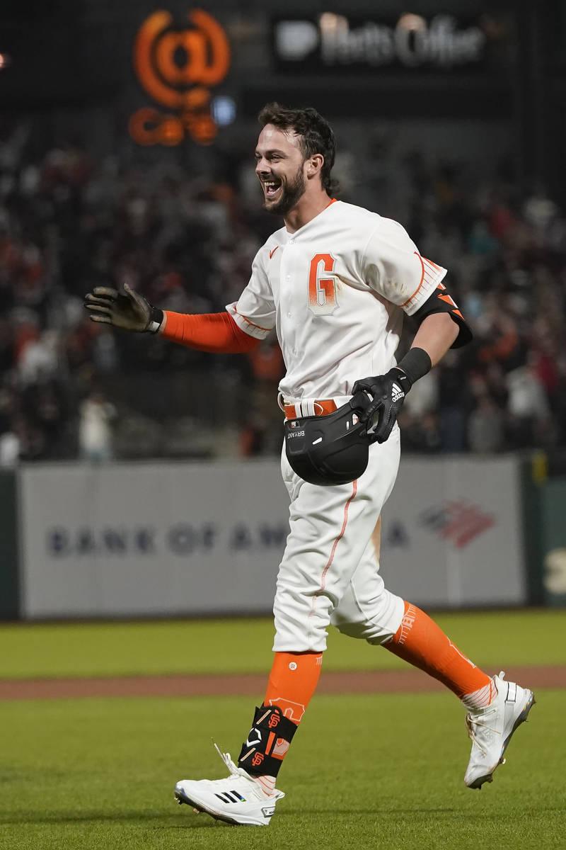 San Francisco Giants' Kris Bryant celebrates after a baseball game against the Arizona Diamondb ...