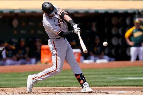San Francisco Giants' Kris Bryant hits a two-run home run against the Oakland Athletics during ...