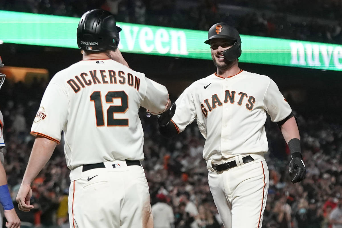 San Francisco Giants' Kris Bryant, right, celebrates after hitting a two-run home run that also ...