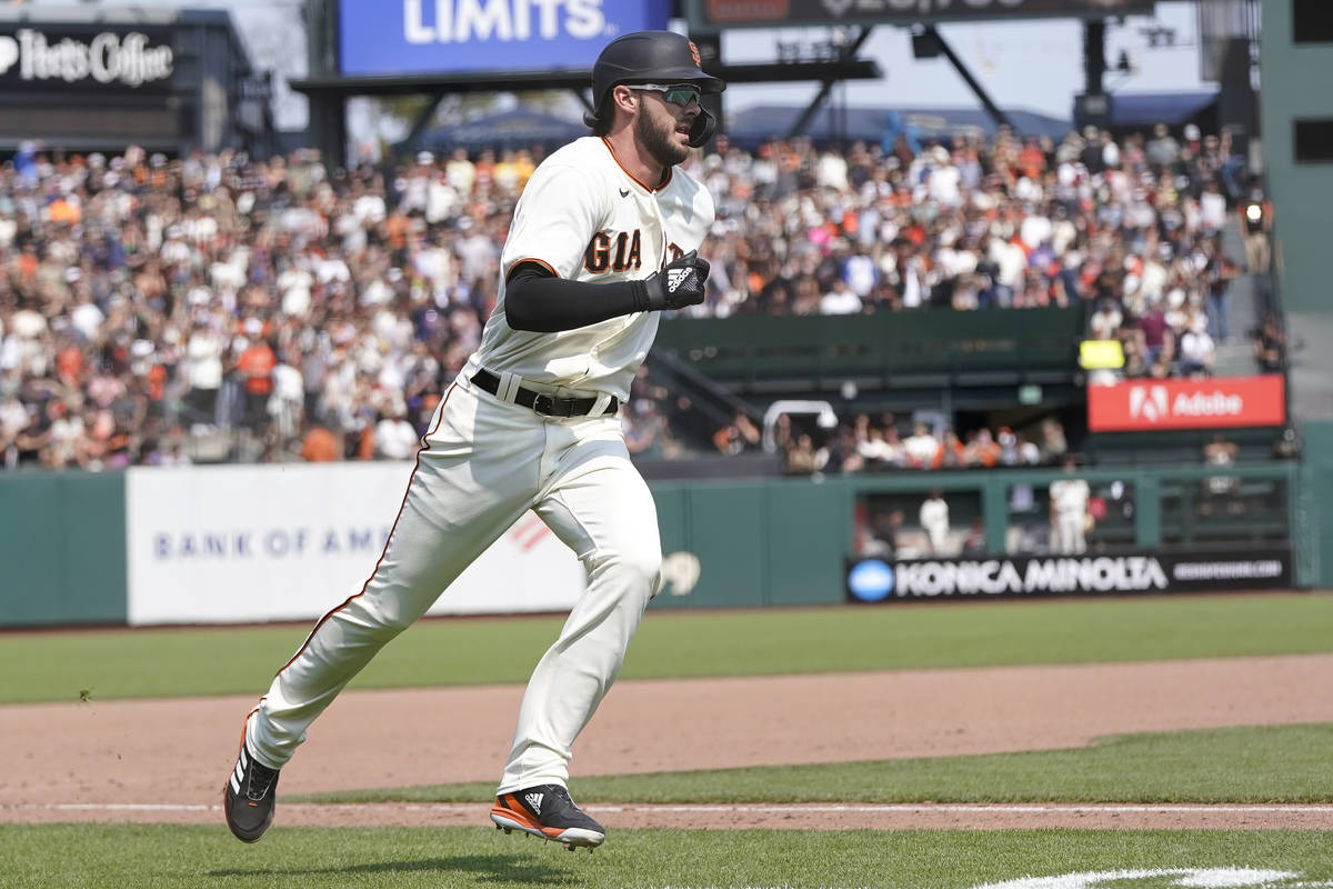 San Francisco Giants' Kris Bryant runs home to score against the Colorado Rockies during the se ...