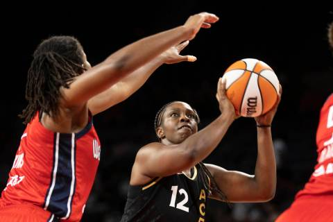 Las Vegas Aces guard Chelsea Gray (12) shoots over Washington Mystics forward Theresa Plaisance ...