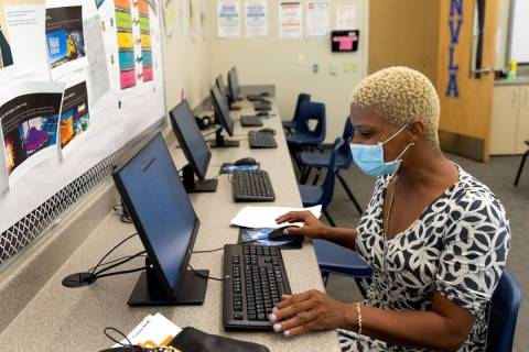Marlisha Wysinger, who has two children enrolled at Nevada Learning Academy at CCSD, fills out ...