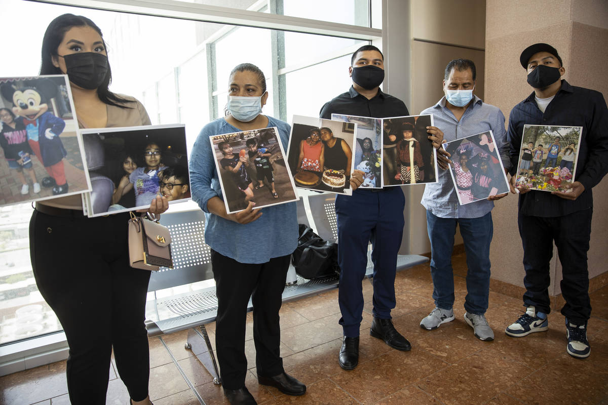 Encarnacion Espana, second from left, mother of 11-year-old Jazmin Espana, who was struck and k ...