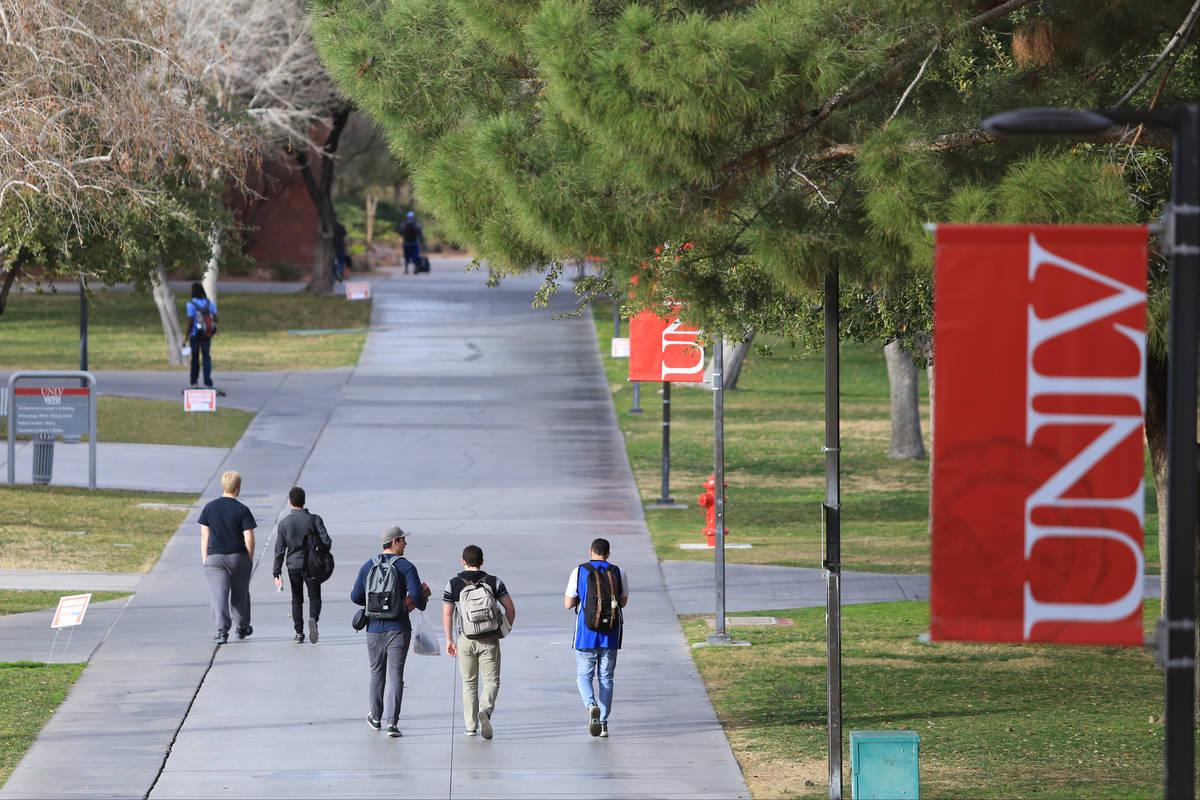 Students walk along a sidewalk at UNLV on Thursday, Feb. 9, 2017, in Las Vegas. (Las Vegas Revi ...