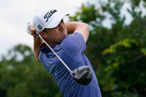Justin Thomas tees off on the third hole in the final round at The Northern Trust golf tourname ...