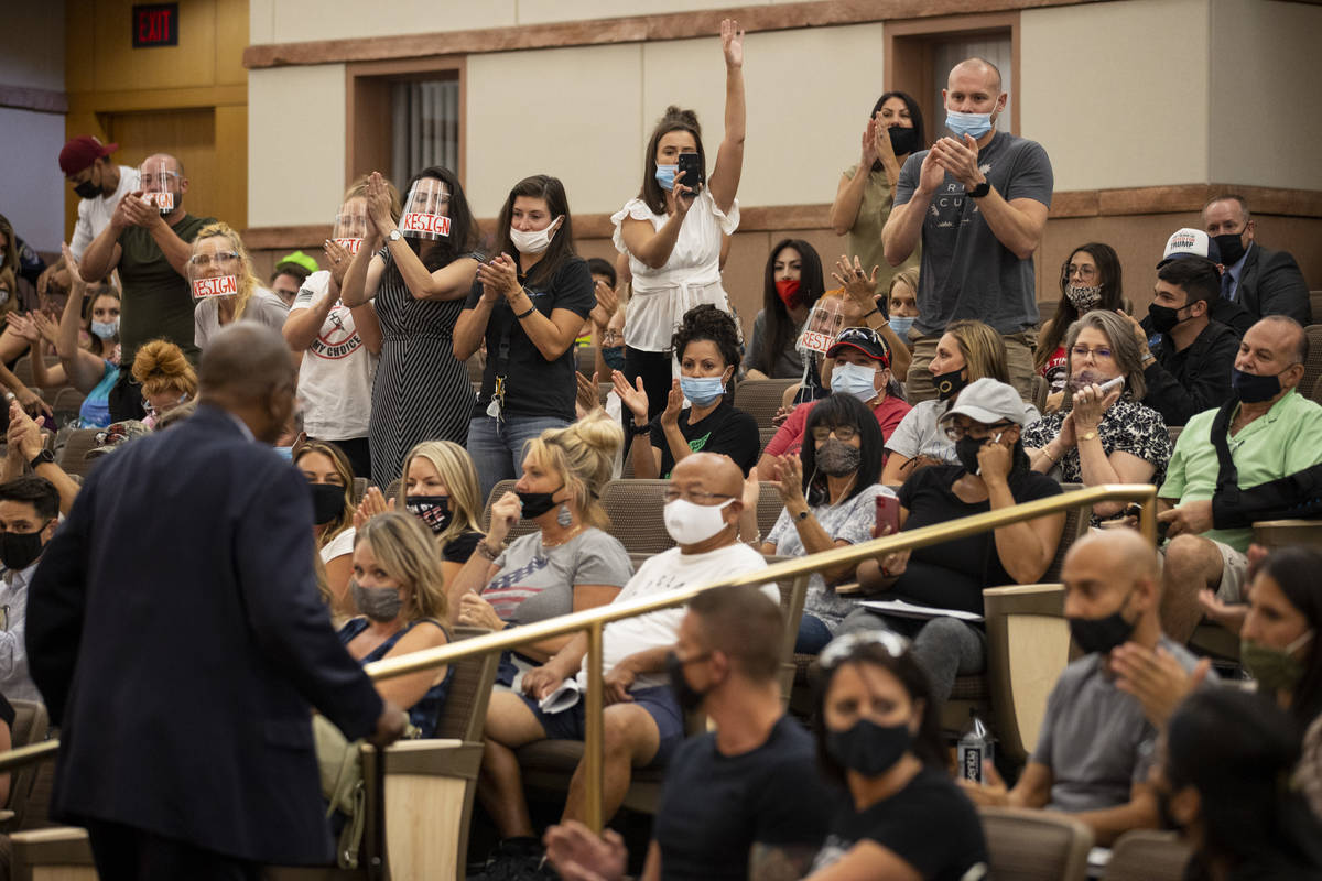 People clap after a comment by former Assemblyman Gene Collins during a Clark County School Dis ...