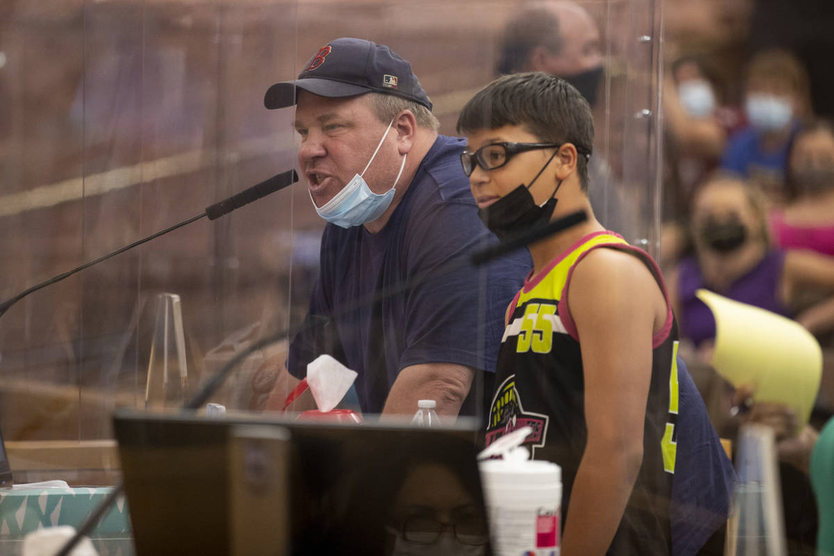 Dyer Lawrence of Las Vegas with his son Luke, 13, speaks during a Clark County School District ...