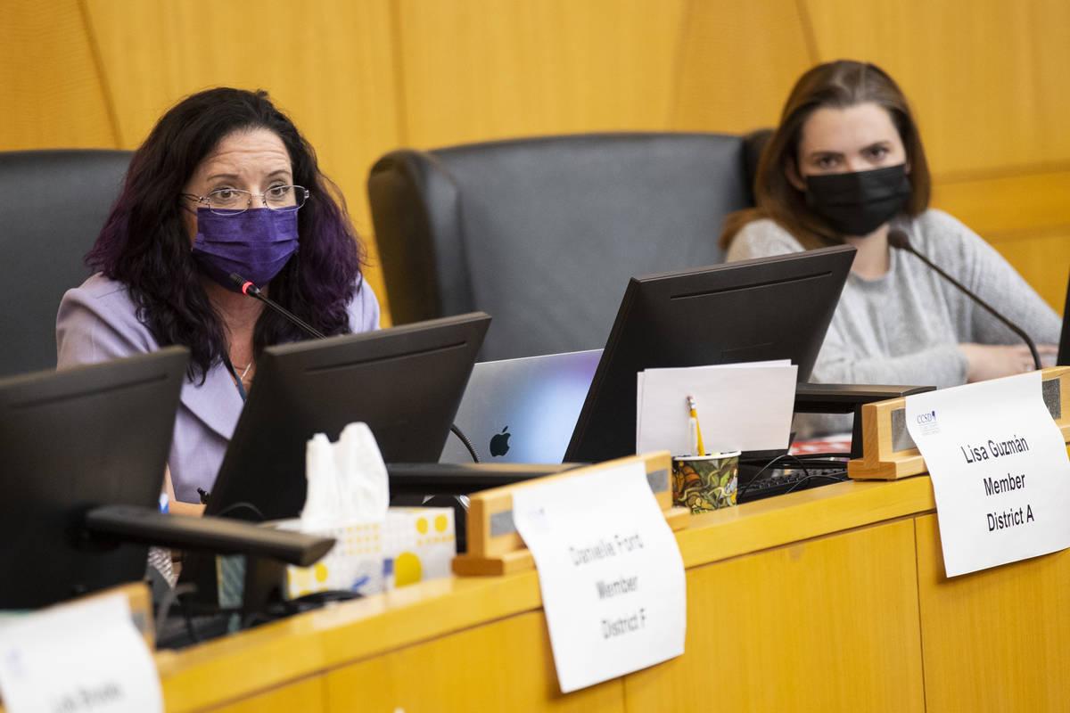 Clark County School District Board of Trustees members Lisa Guzman, left, and Katie Williams, p ...
