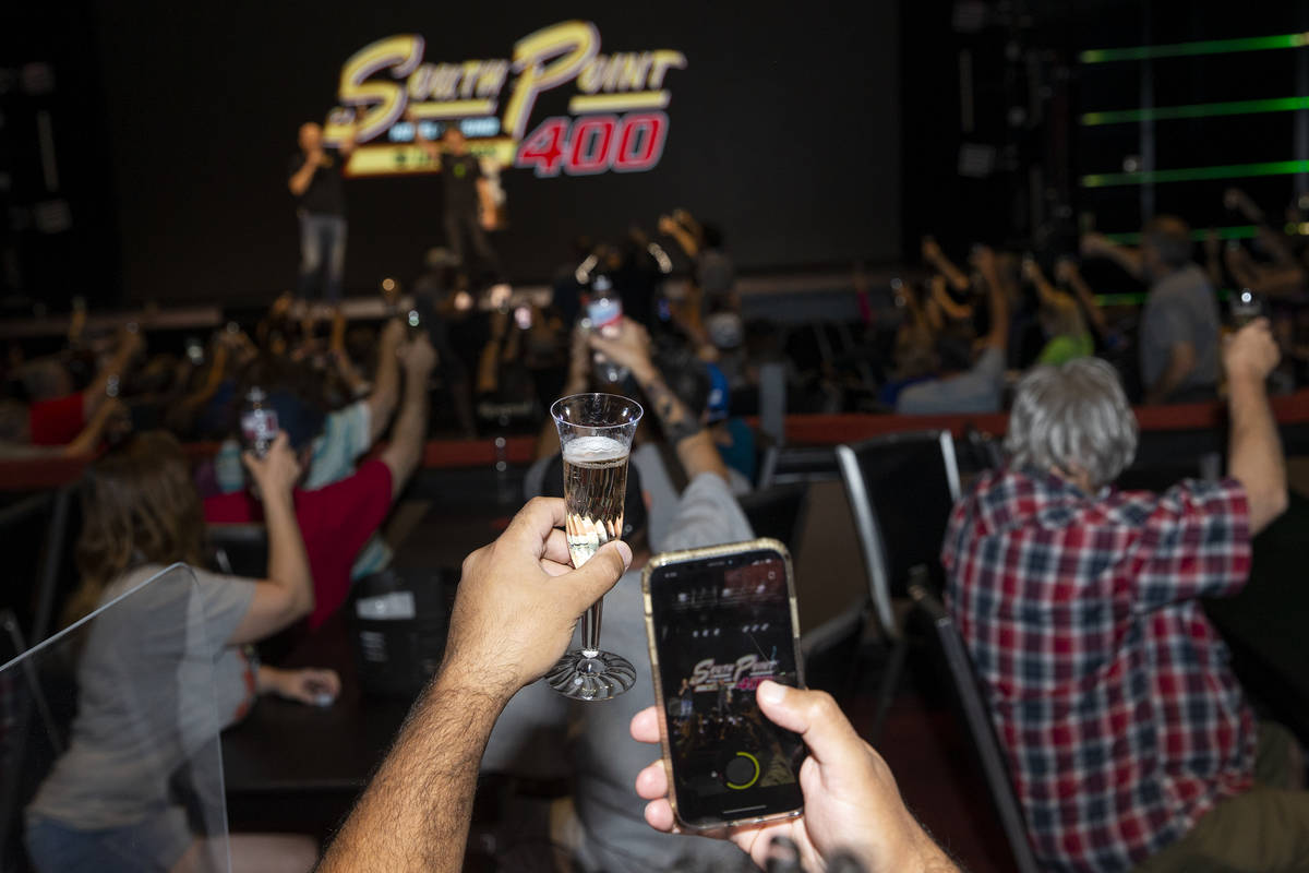 Fans toast to last year's South Point 400 champion, Kurt Busch, who is from Las Vegas, during a ...