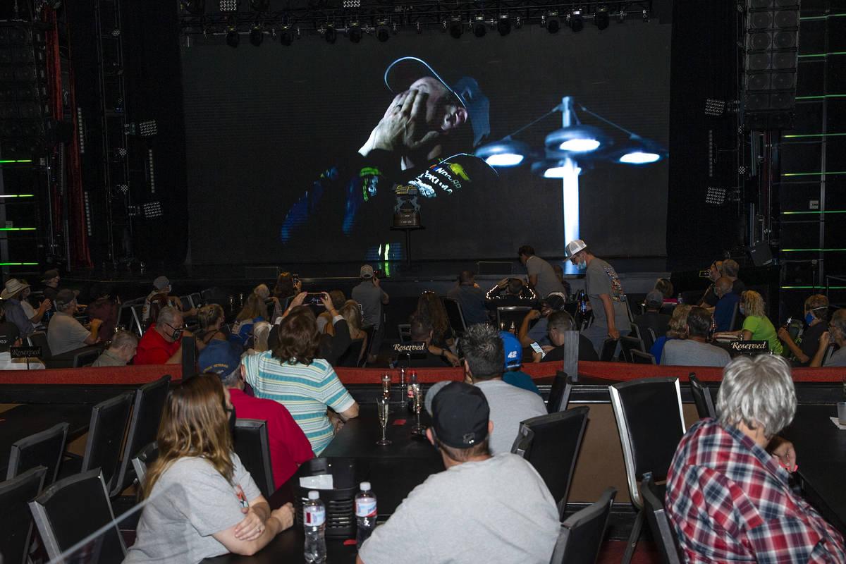 Fans watch footage of Kurt Busch, a NASCAR driver from Las Vegas, winning the 2020 South Point ...