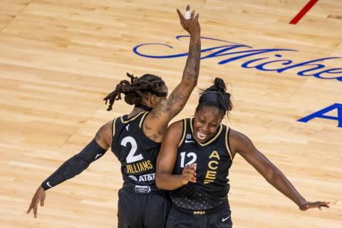 Las Vegas Aces guard Riquna Williams (2) and teammate guard Chelsea Gray (12) celebrate anothe ...