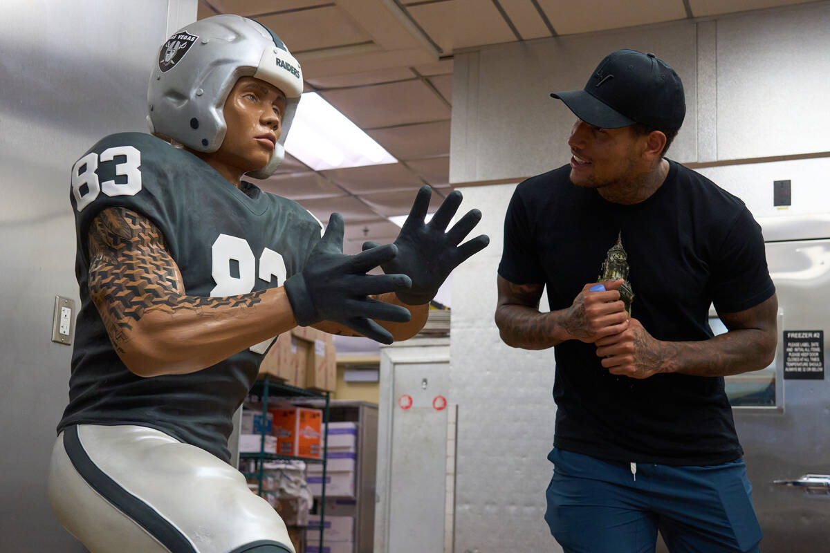 Raiders Darren Waller meets a chocolate statue of himself that will be featured at ARIA Patisse ...