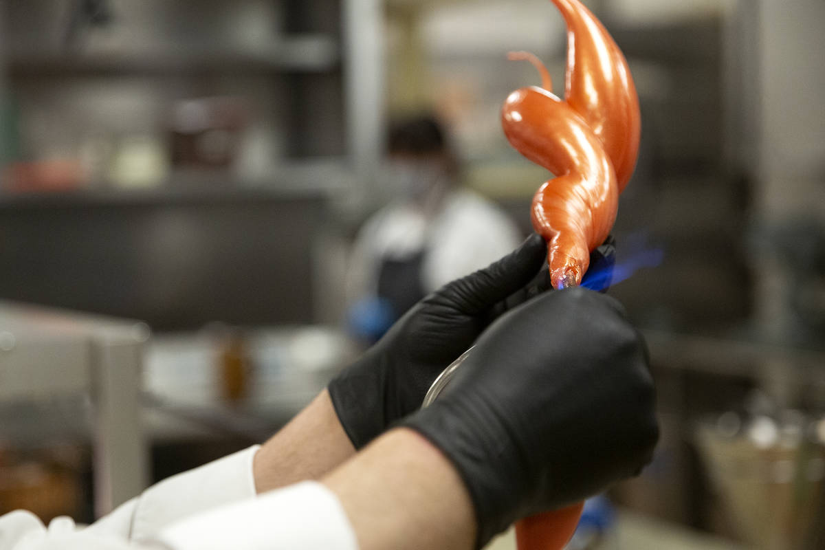 Executive pastry chef Mathieu Lavallee torches a blown sugar flame that will adorn the Raiders ...