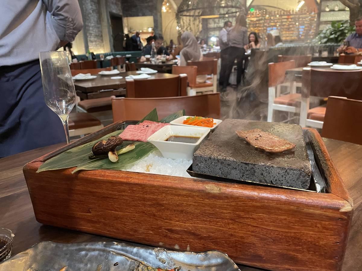 A5 Japanese Miyazaki Wagyu, prepared tableside on CATCH's signature hot stone, feature yuzu s ...