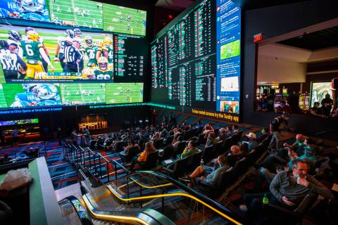 Football fans take in the action at the Circa Sportsbook as NFL games play across the 78-millio ...