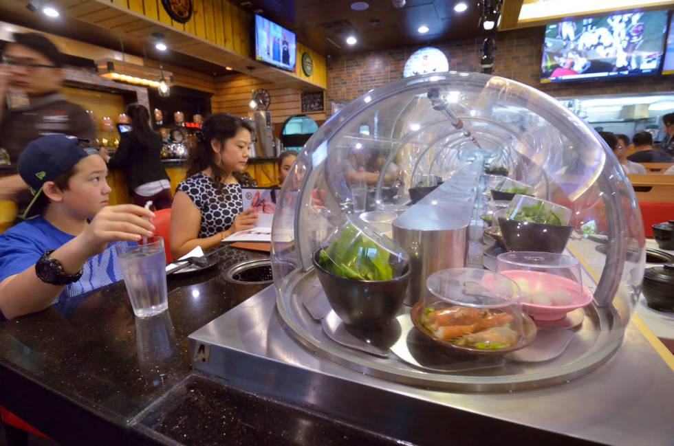 A conveyor belt brings food directly to diners at the Chubby Cattle restaurant.(rjmagazine)