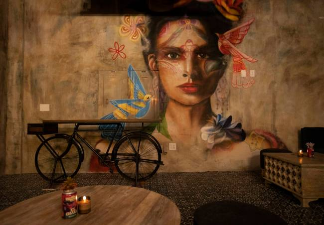 Artist Mallory Dawn painted this mural, which is seen in the speakeasy bar at Màs Por Favo ...