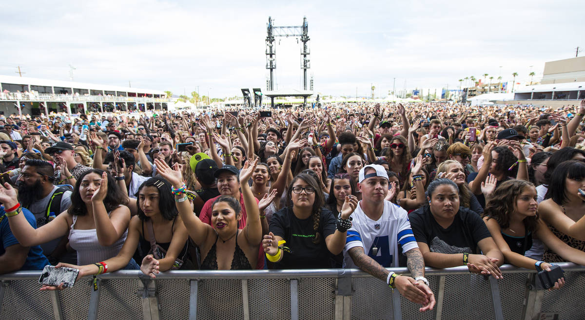 Fans react as Lewis Capaldi, not pictured, performs at the downtown stage during day 3 of the L ...