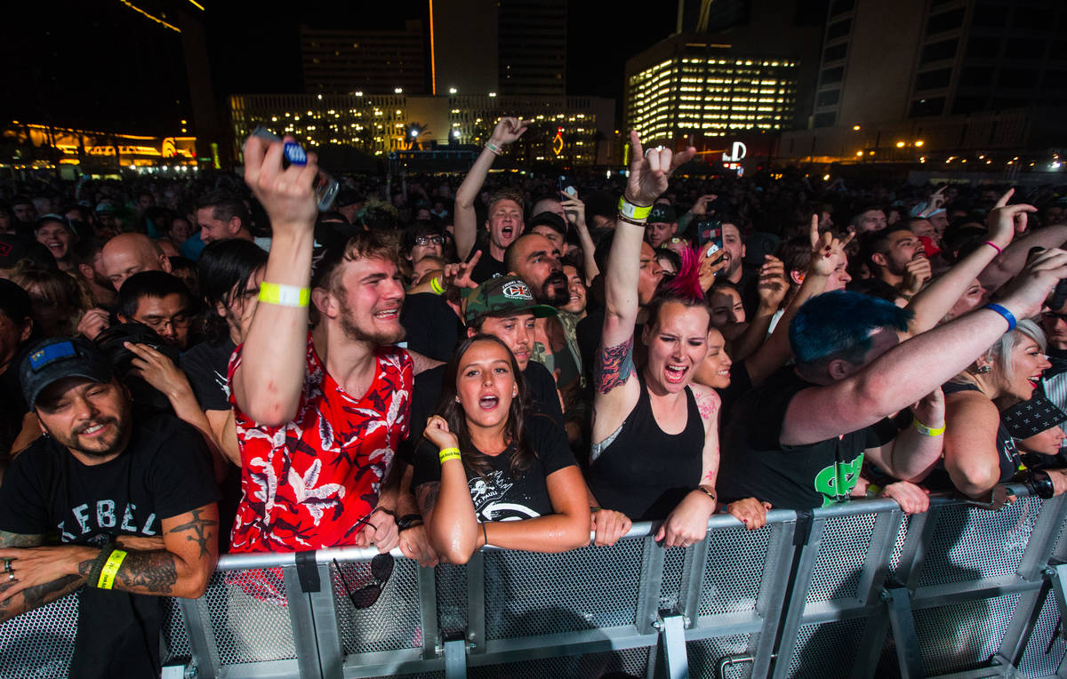 Attendees react as Rise Against performs during the first day of the Punk Rock Bowling music fe ...