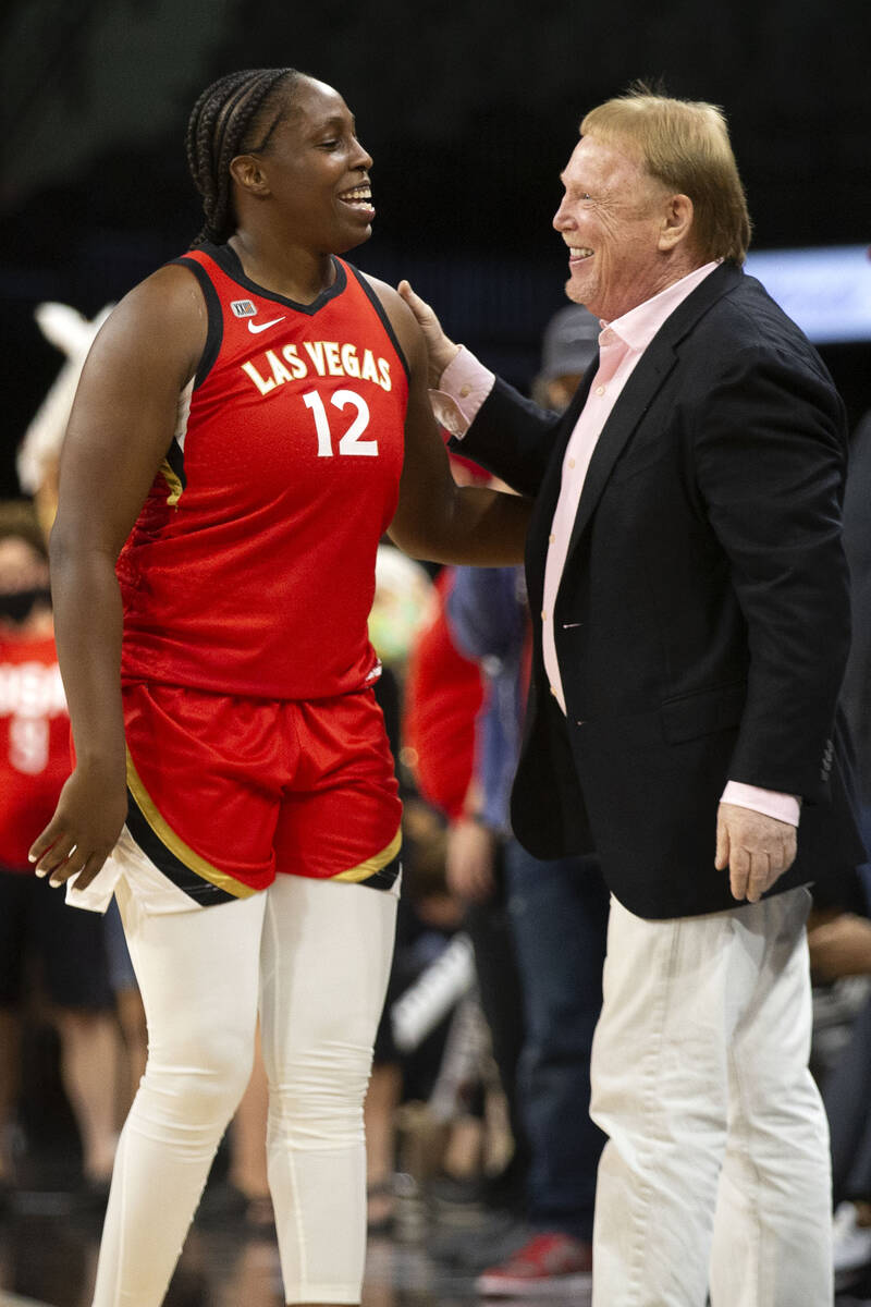 Las Vegas Aces guard Chelsea Gray (12) and Las Vegas Raiders owner Mark Davis share a moment af ...
