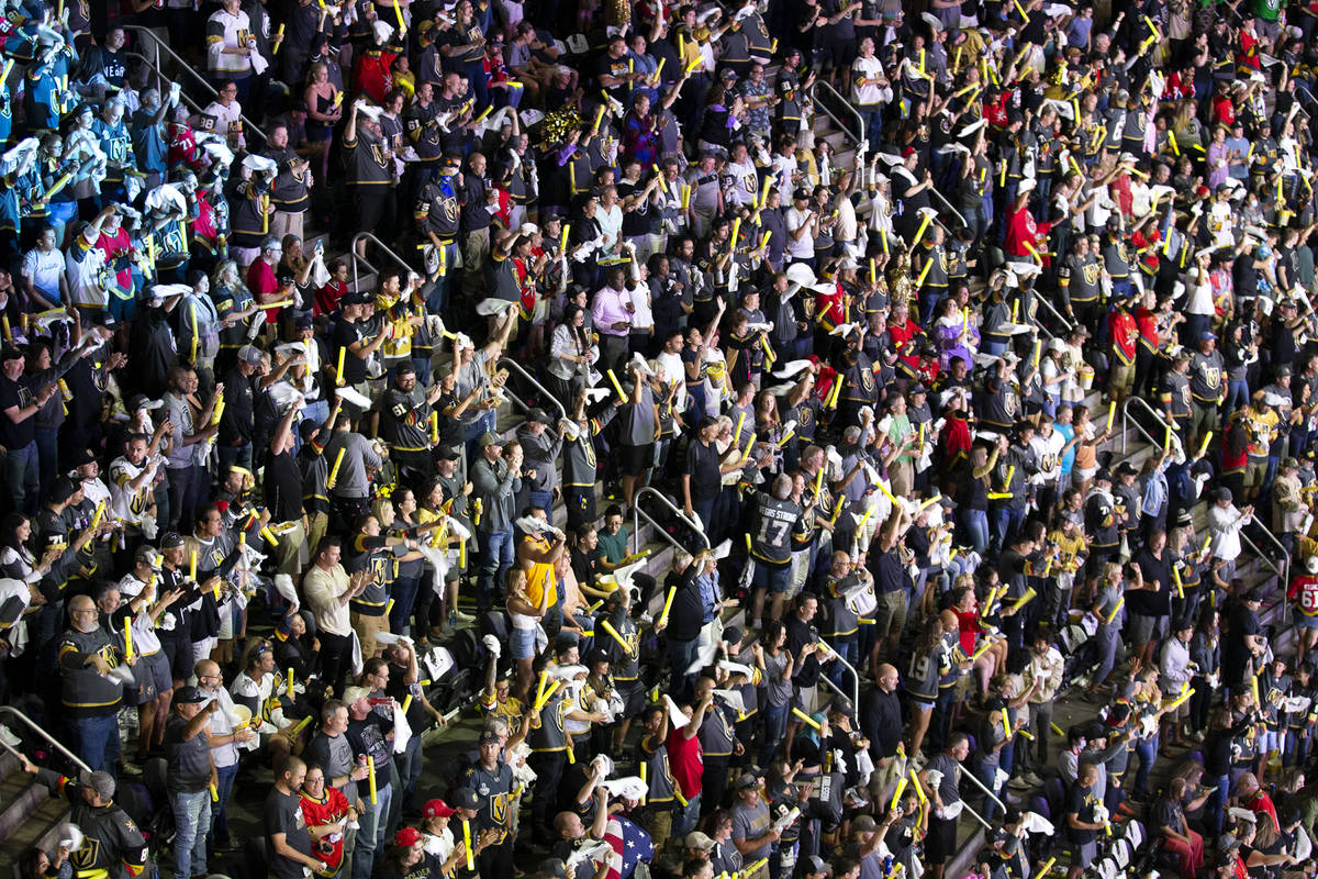 The crowd goes wild after Golden Knights defenseman Shea Theodore (27) scored the first goal ag ...