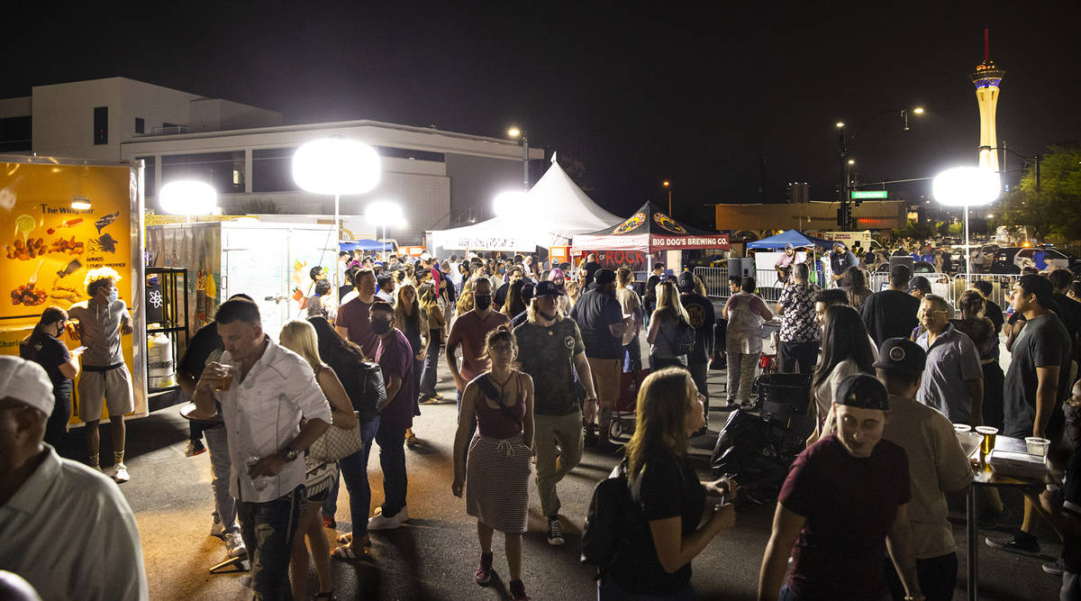 Attendees roam around food vendors during First Friday in the Arts District of downtown Las Veg ...
