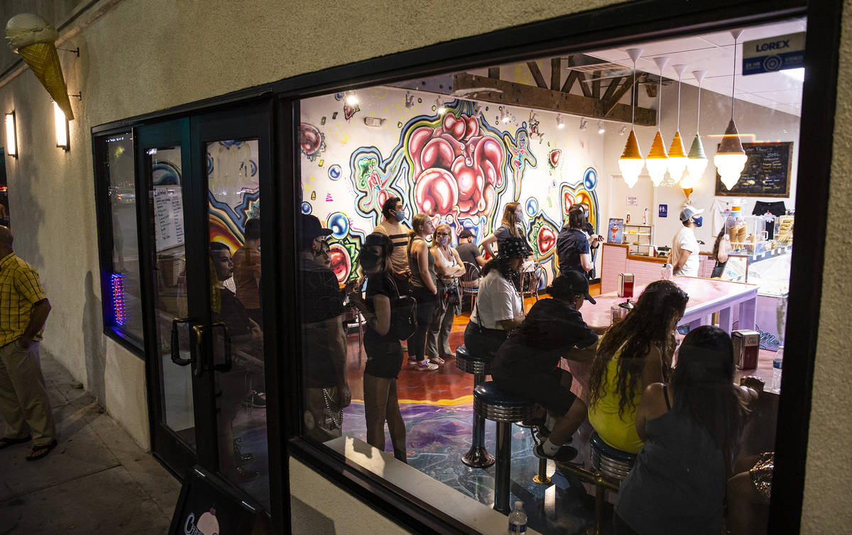 People line up for sweet treats at Cream Me Ice Creamery during First Friday in the Arts Distri ...