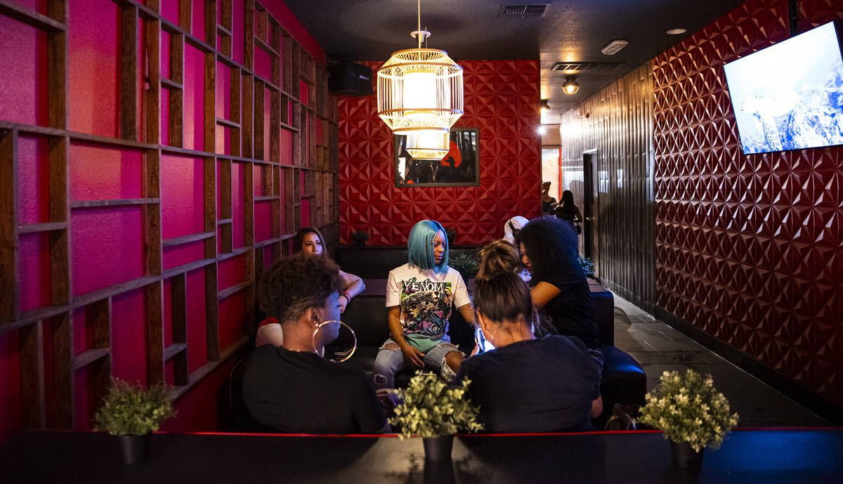 People hang out at Ninja Karaoke during First Friday in the Arts District of downtown Las Vegas ...
