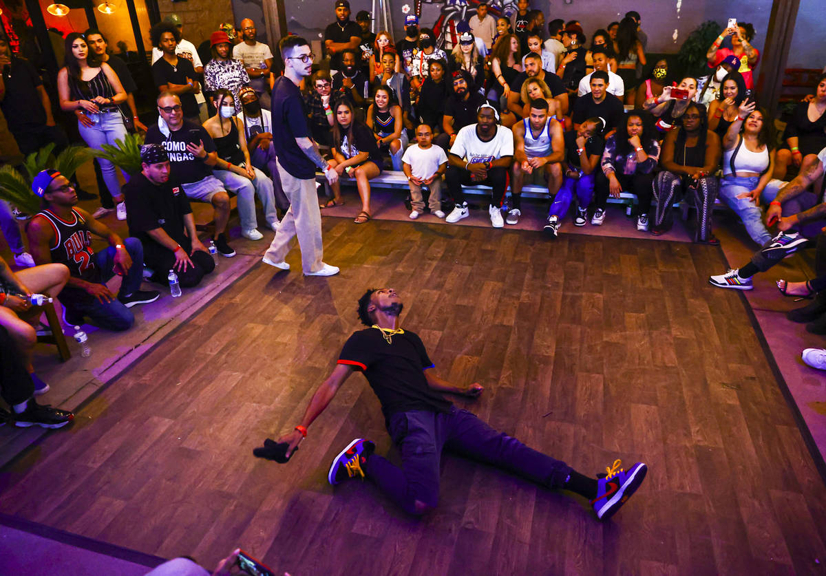 People compete in the dance battle at Ninja Karaoke during First Friday in the Arts District of ...