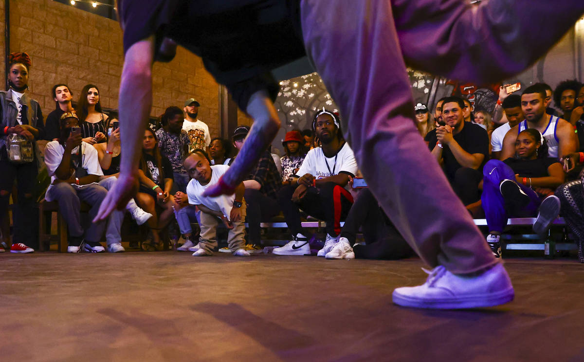 """Comedian and dancer """"K1ng Dwarf"""" looks on as Anthony """"A-HAT"""" Hatmaker competes in the dance ..."""
