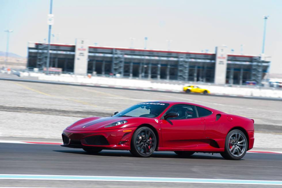 Exotics Racing Co-Owner, Romain Thievin, drives a Ferrari 458 Scuderia around the Exotics Racin ...