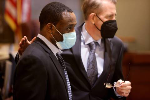 Antonio Bridges, left, who is charged in the death of his girlfriend's 1-year-old son, talks wi ...