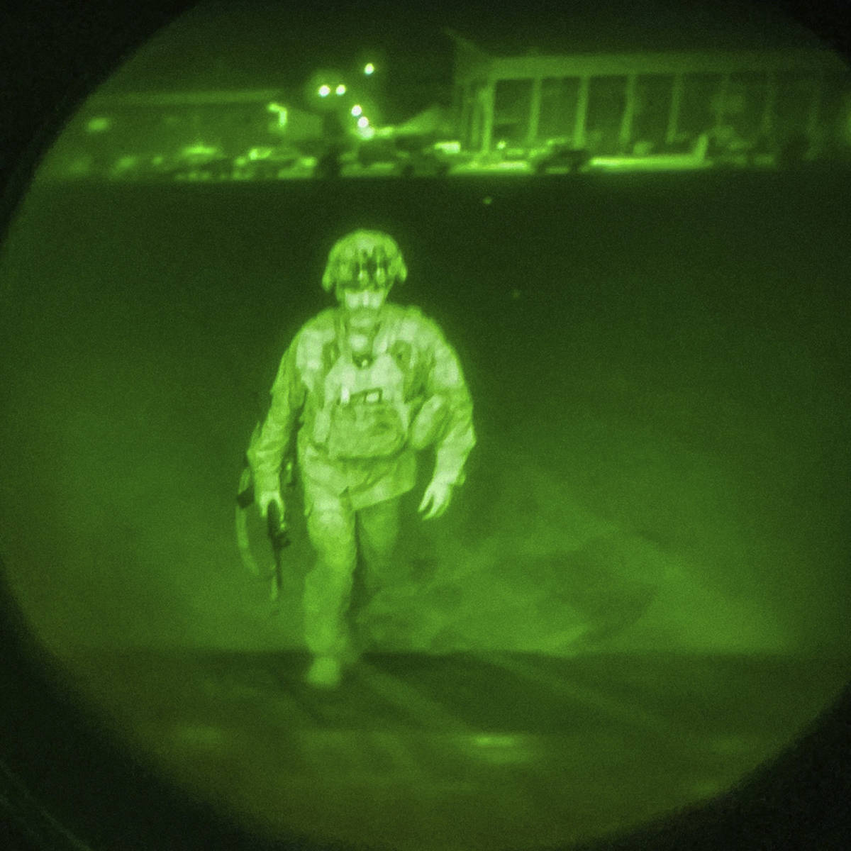 In this image made through a night vision scope and provided by the U.S. Army, Maj. Gen. Chris ...