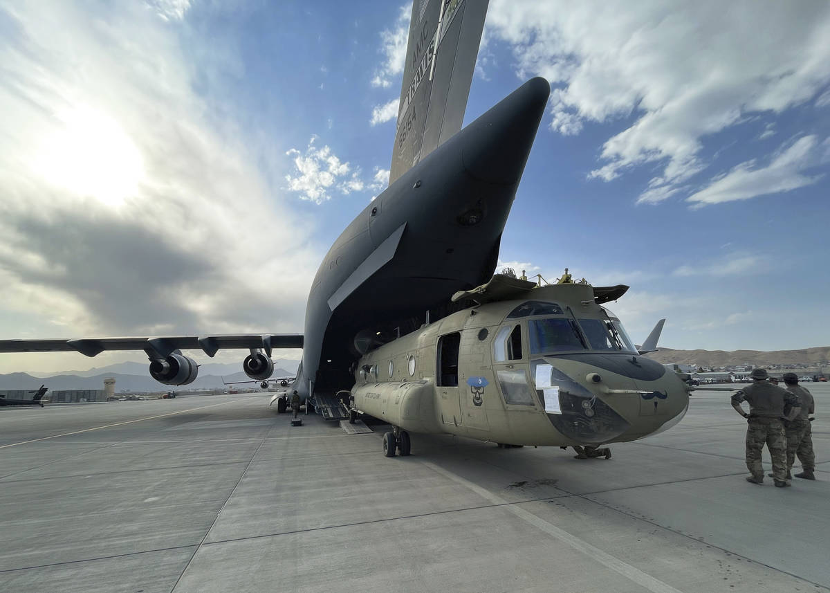 In this image provided by the Department of Defense, a CH-47 Chinook from the 82nd Combat Aviat ...