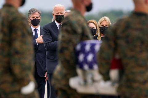 President Joe Biden looks on at a transfer case with the remains of Marine Corps Cpl. Humberto ...