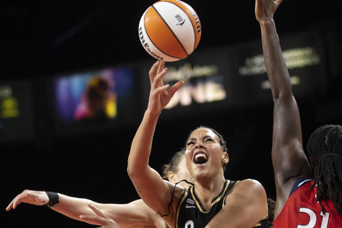 Las Vegas Aces center Liz Cambage (8) slices to the rim past Washington Mystics center Tina Cha ...