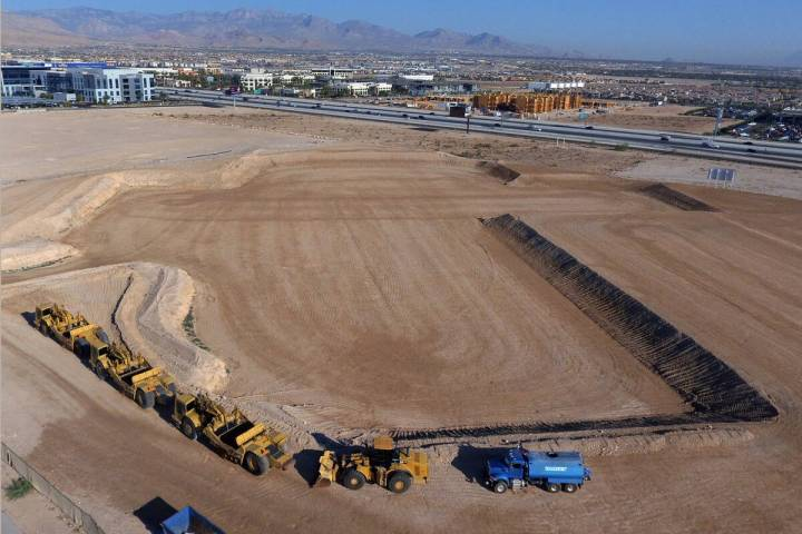 A giant hole in the ground at 8030 W Maule Ave., is shown in the southwest Las Vegas Valley whe ...