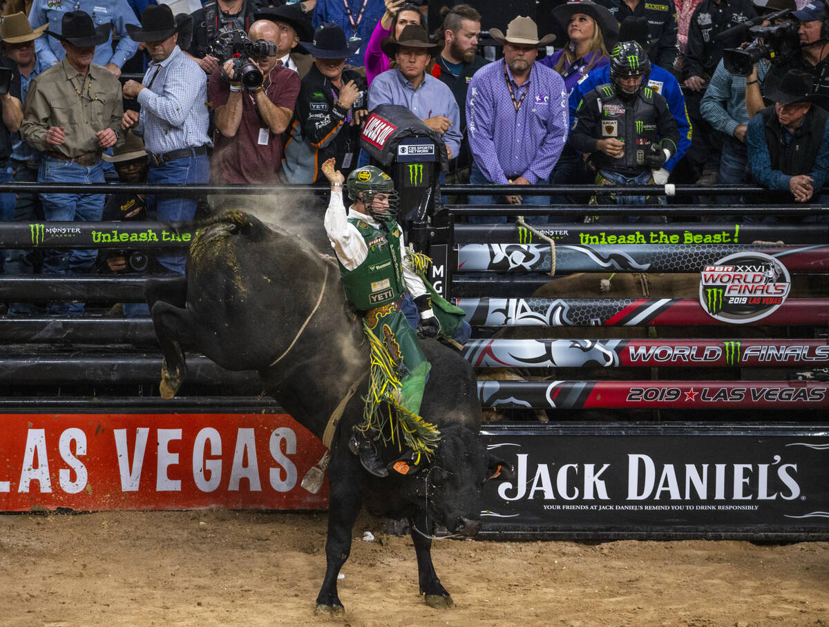 Jess Lockwood rides tall on Rising Sun during the last day of the PBR World Finals at T-Mobile ...