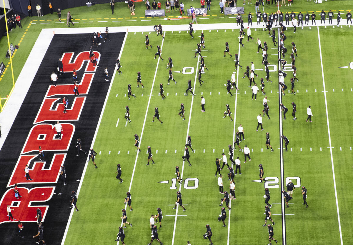 UNLV Rebels players warm up before an NCAA football game against Eastern Washington University ...
