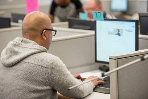 Shaun Lertswan, 40, searches for jobs on a computer at the Nevada JobConnect Center in Las Vega ...