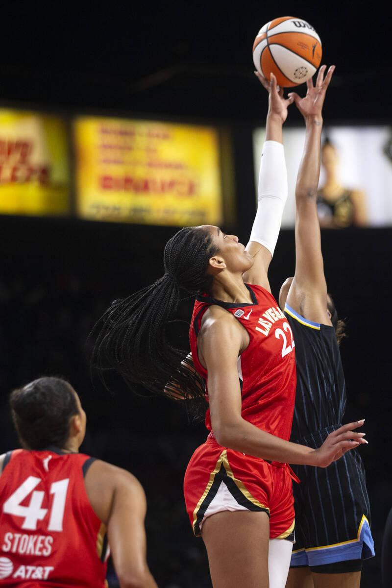 Las Vegas Aces forward A'ja Wilson (22) jumps for the ball with Chicago Sky forward/center Azur ...