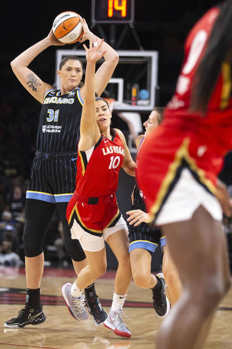 Chicago Sky center Stefanie Dolson (31) looks to pass while Las Vegas Aces guard Kelsey Plum (1 ...