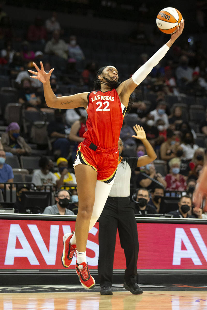 Las Vegas Aces forward A'ja Wilson (22) regains control of the ball during the first half of a ...